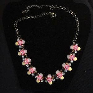 Costume jewelry pink flower with multiple cz's